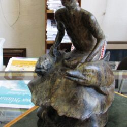 Soapstone Boy and Dolphins